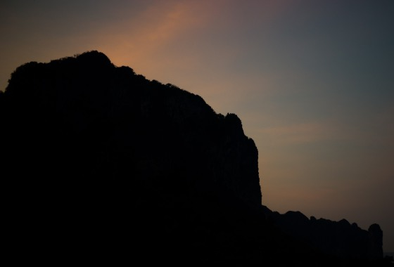 dawn glow behind the cliff in Aonang