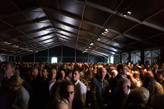 The official ceremony was held in  a crowded tent...