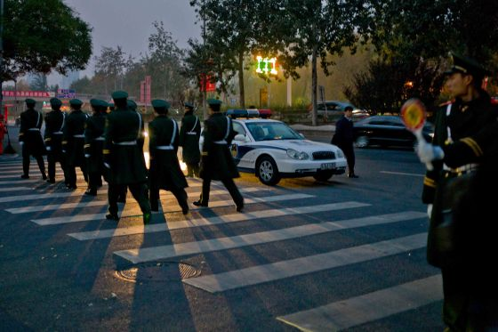 Chinese soldiers marching at dawn in Beijing