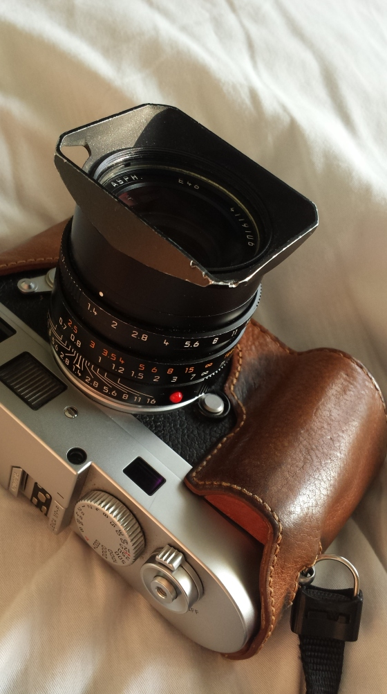 my trusty Leica M9P such as it is today, dented hood and all