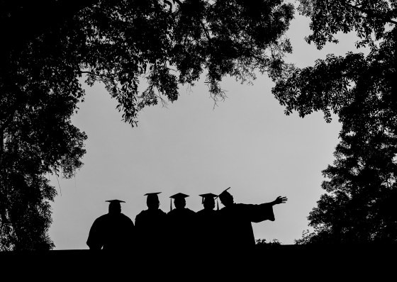 Graduates posing in the scenic surrounds
