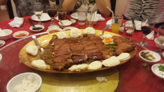 awesome suckling pig on bed of glutinous rice