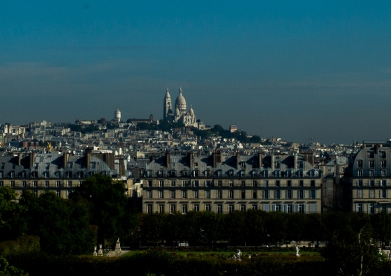 view of the Sacre Coeur church on the hill in Montmartre as seen from Musee d'Orsay
