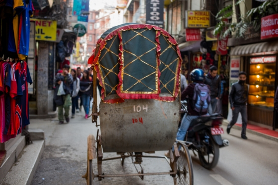 the street of Thamel are narrow and crowded and pedestrians share the road with vehicvles