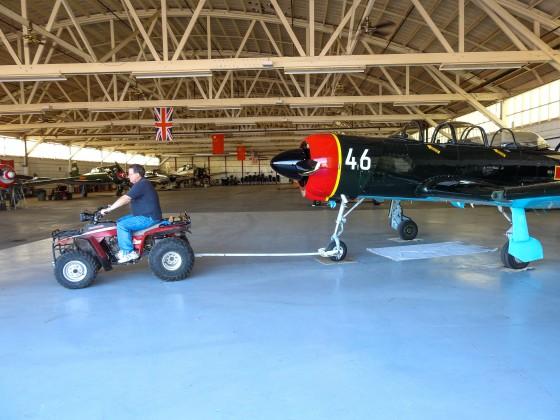 Warren towing his Nanchang CJ6 out of the hangar...