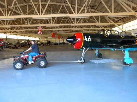 Warren towing his Nanchang CJ6 out of the hangar...