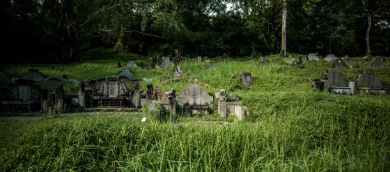 Graves and headstones dotted the hilly terrain as we walked