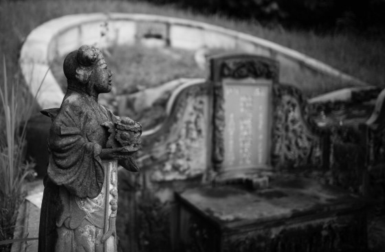 on either side of the headstones were a lady, the jade lady and a male, the golden boy..
