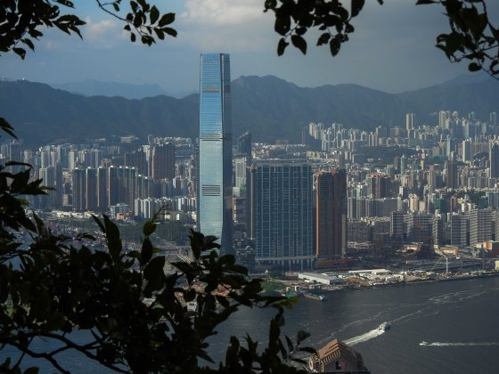 The ICC Building on the Kowloon side shimmered brilliantly blue
