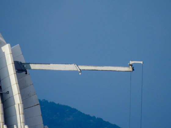 And zooming in big time....this pole turned out to be a boom suspending the cables for the window cleaning equipment!