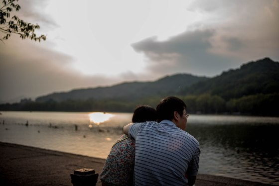and lovers huddled as the sun set on xihu
